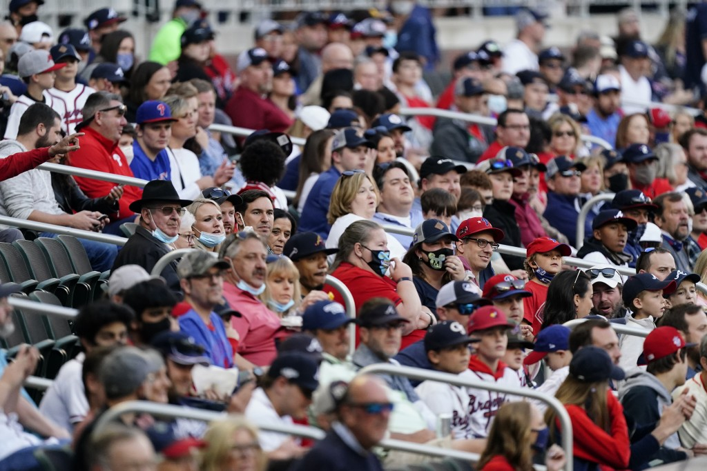 Baseball fans watch a game between the Philadelphia Phillies and the Atlanta Braves, Friday, May 7, 2021, in Atlanta. The Braves opened the stadium to...