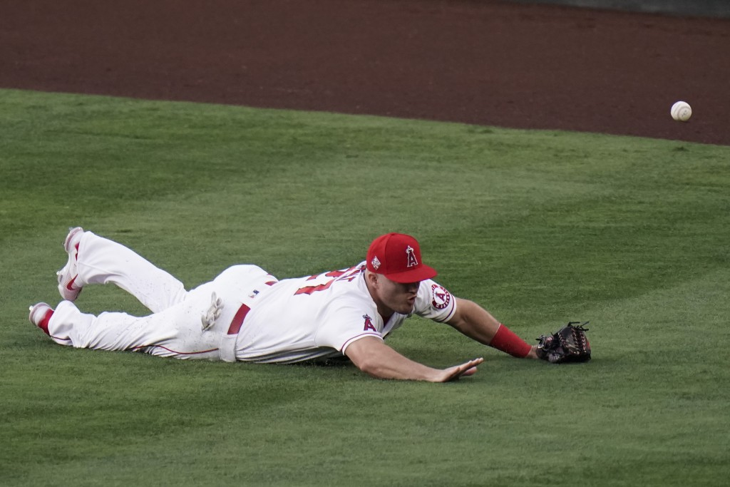 Los Angeles Angels' Mike Trout misses a double hit by Los Angeles Dodgers' AJ Pollock during the second inning of a baseball game, Friday, May 7, 2021...
