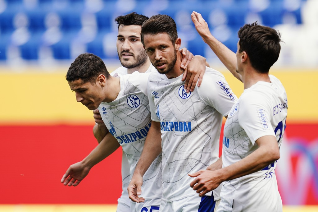Schalke's scorer Mark Uth, second right, and his teammates celebrate the opening goal during the German Bundesliga soccer match between TSG 1899 Hoffe...
