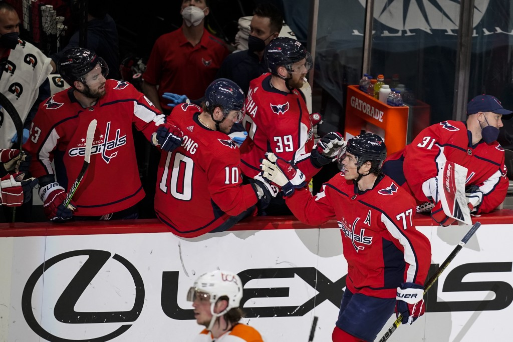 Washington Capitals right wing T.J. Oshie (77) celebrates his goal during the second period of an NHL hockey game against the Philadelphia Flyers, Fri...