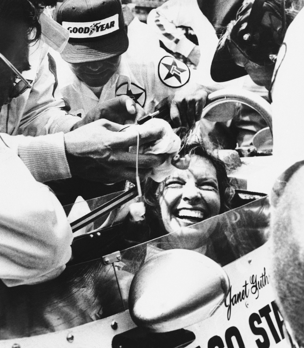 FILE - Janet Guthrie is all smiles as her pit crew swarms around her following her run in the Indy 500-mile race in Indianapolis, in this May 28, 1978...