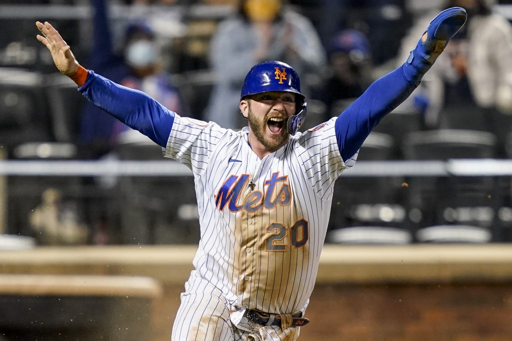 New York Mets' Pete Alonso celebrates after scoring the game-winning run against the Arizona Diamondbacks in the 10th inning of a baseball game Friday...