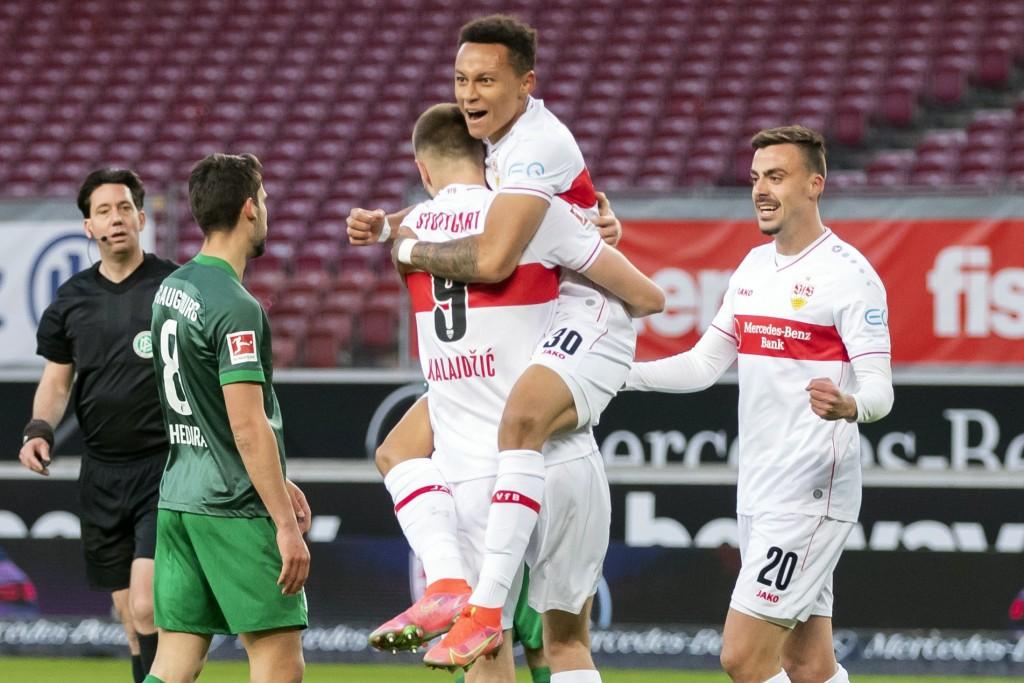 Stuttgart's Philipp Forster, right, celebrates scoring with teammates Roberto Massimo and Stuttgart's Sasa Kalajdzic, left, during the Bundesliga socc...