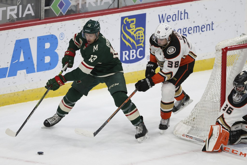 Minnesota Wild's Nick Bonino (13) controls the puck against Anaheim Ducks' Derek Grant (38) during the first period of an NHL hockey game Friday, May ...