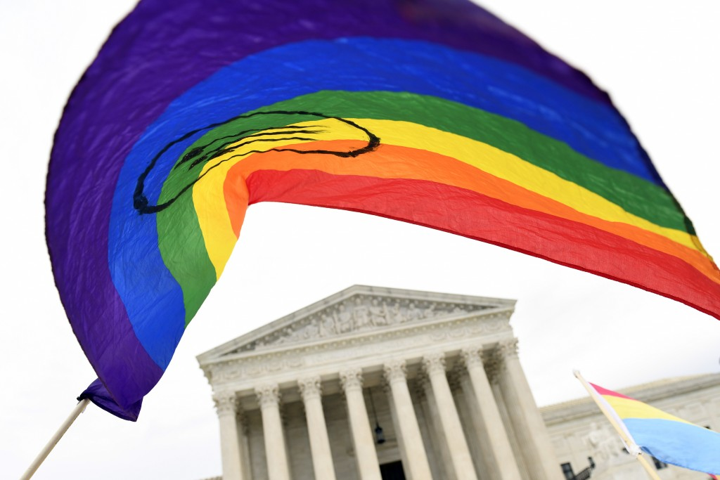 FILE - In this Oct. 8, 2019, file photo, protesters gather outside the Supreme Court in Washington. Legislation that would create new protections for ...