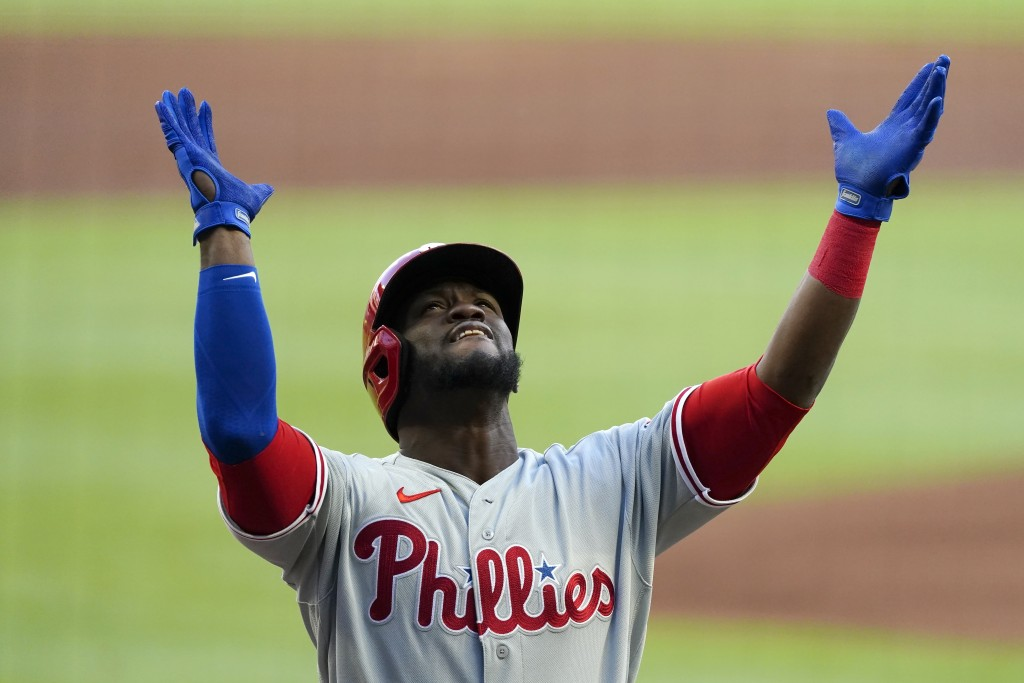 Philadelphia Phillies' Odubel Herrera reacts as he crosses the plate after hitting a three-run home run in the first inning of a baseball game against...