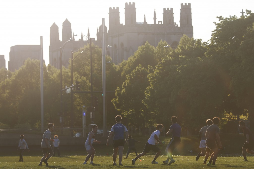 FILE - In this May 6, 2021, file photo, University of Chicago men's rugby team players practice on the Midway Plaisance near the campus in Chicago. Ev...