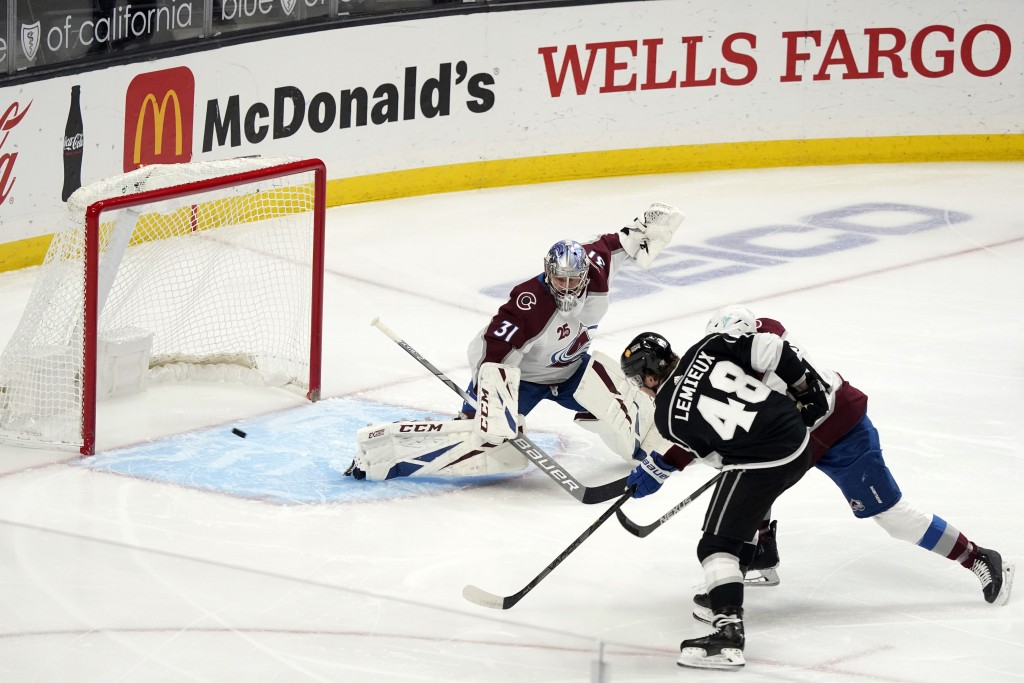 Los Angeles Kings left wing Brendan Lemieux (48) scores past Colorado Avalanche goaltender Philipp Grubauer (31) during the first period of an NHL hoc...