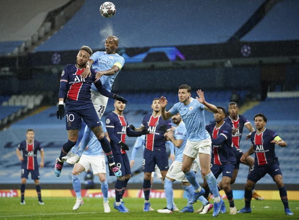 PSG's Neymar, left, challenges Manchester City's Fernandinho during the Champions League semifinal second leg soccer match between Manchester City and...