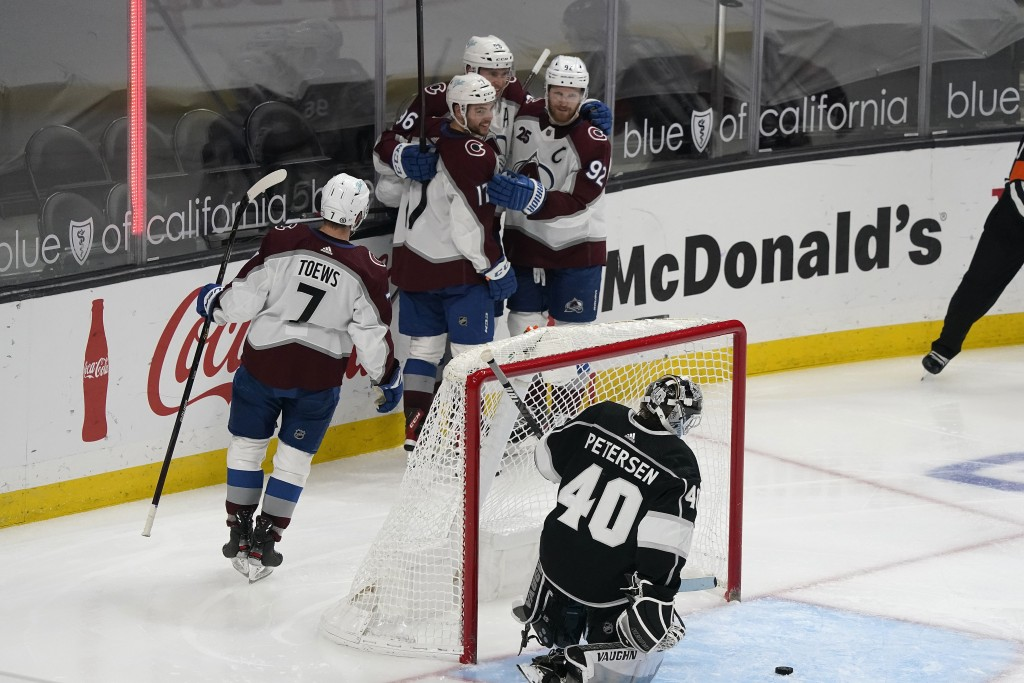 Colorado Avalanche center Tyson Jost (17) celebrates his goal with teammates during the second period of an NHL hockey game against the Los Angeles Ki...