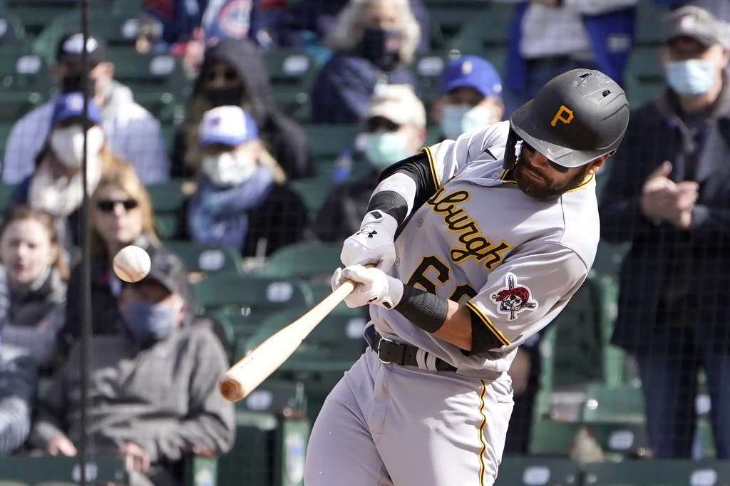 Pittsburgh Pirates' Ka'ai Tom hits an RBI-single during the ninth inning of a baseball game against the Chicago Cubs, Friday, May 7, 2021, in Chicago....