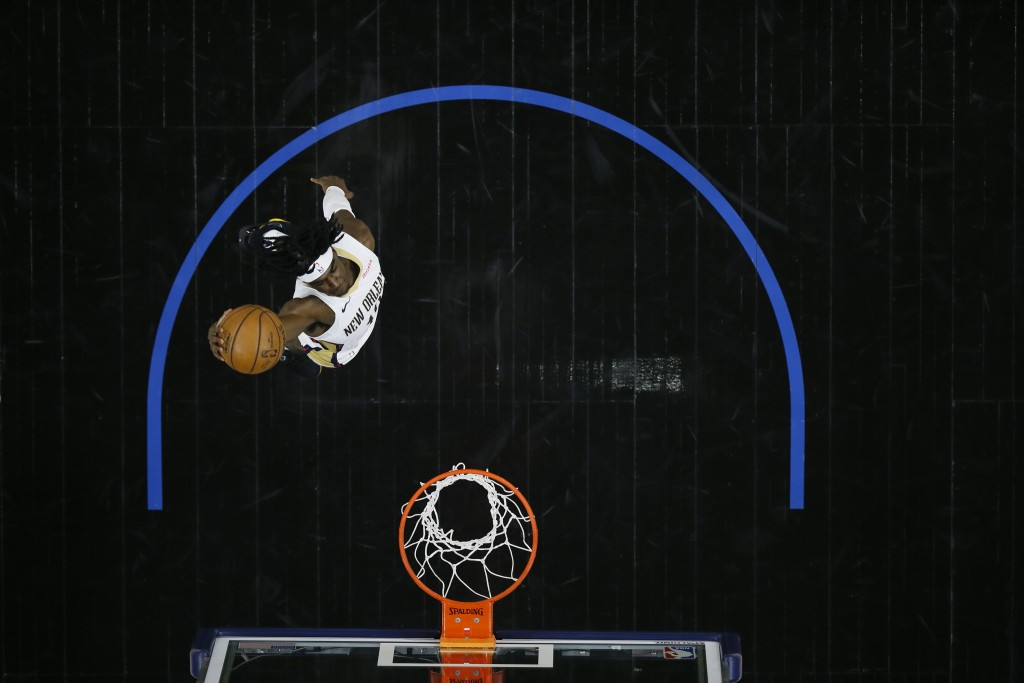 New Orleans Pelicans' Kira Lewis Jr. goes up for a dunk during the second half of an NBA basketball game against the Philadelphia 76ers, Friday, May 7...