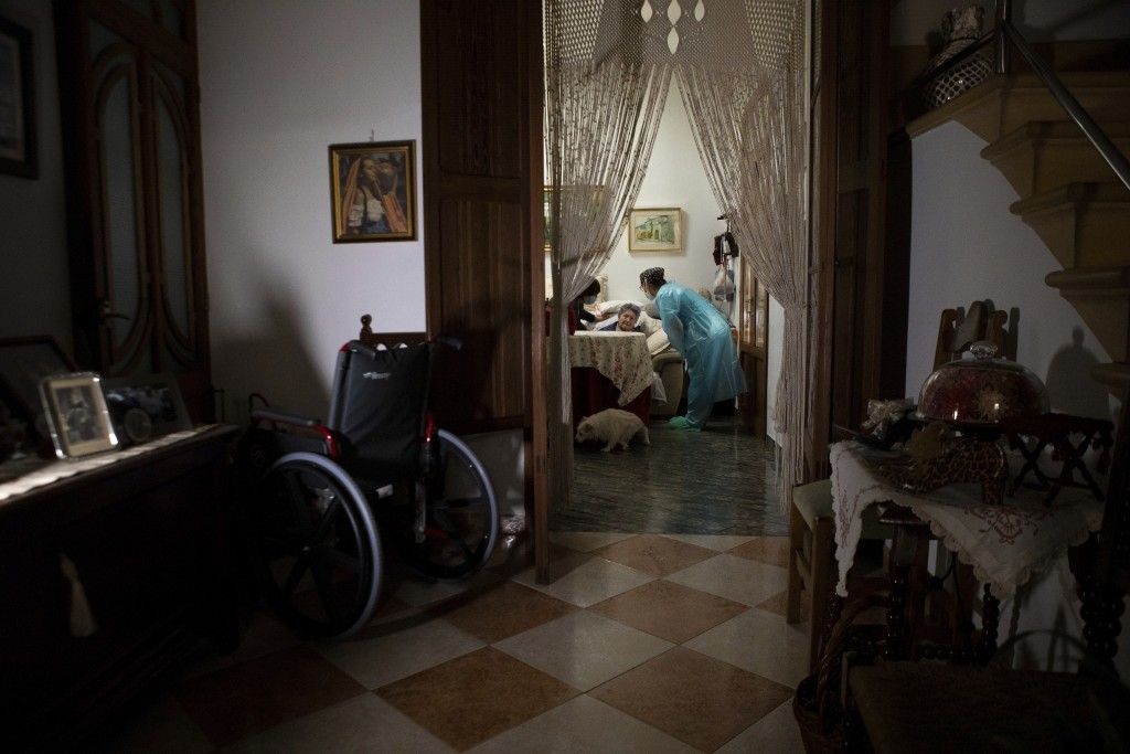 Nurse Pilar Rodríguez speaks with Paula Serra Caldes, 93, as she explains to her about vaccination against COVID-19, in the town of Sa Pobla on the Sp...