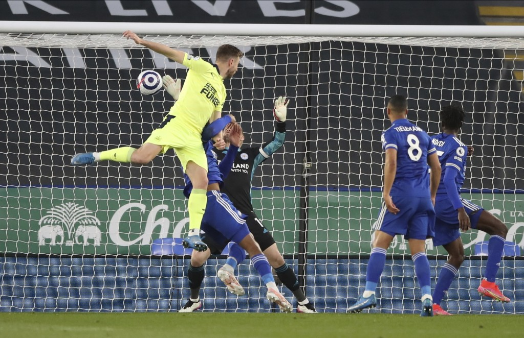 Newcastle's Paul Dummett, left, scores his team's second goal during the English Premier League soccer match between Leicester City and Newcastle Unit...