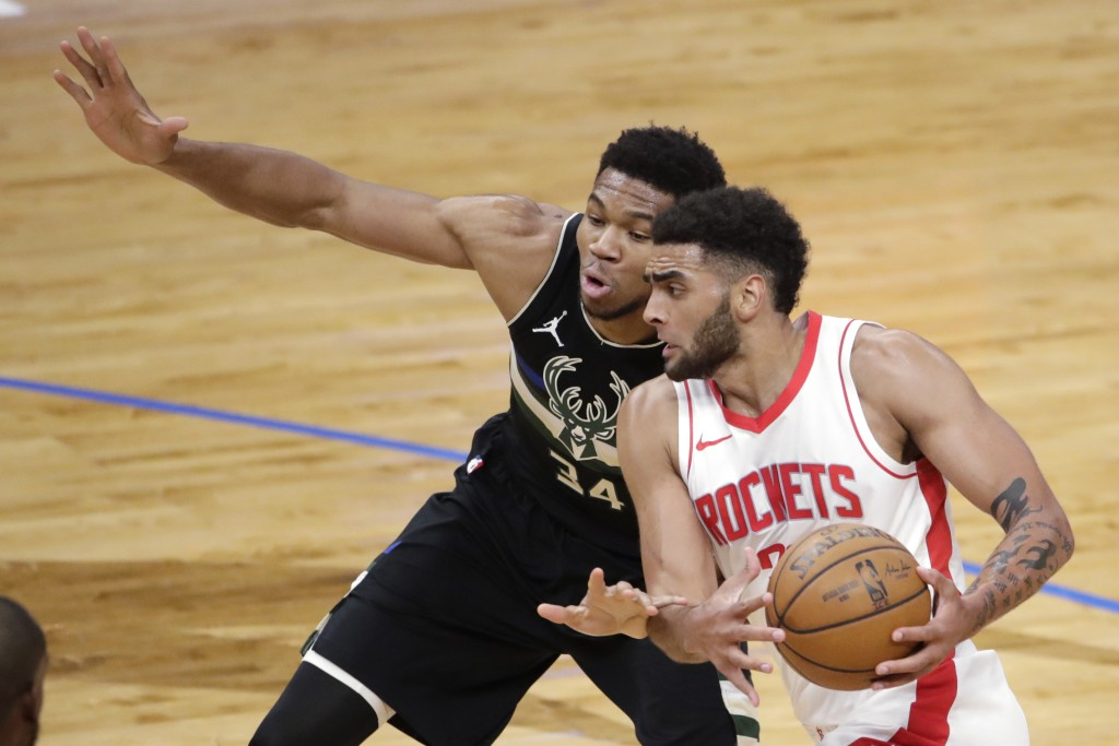 Houston Rockets' Anthony Lamb drives to the basket against Milwaukee Bucks' Giannis Antetokounmpo (34) during the first half of an NBA basketball game...