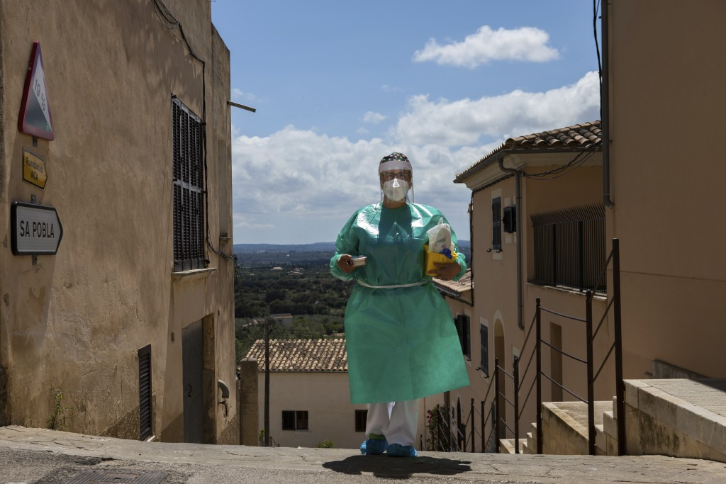 Nurse Pilar Rodríguez arrives at the small town of Buger, barely a thousand inhabitants, at the Spanish Balearic Island of Mallorca, Spain, Friday, Ap...