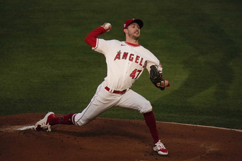Los Angeles Angels starting pitcher Griffin Canning throws against the Los Angeles Dodgers during the first inning of a baseball game, Friday, May 7, ...