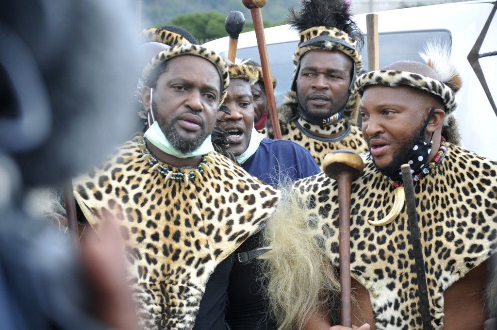 Prince Misuzulu Zulu, left, flanked by fellow warriors in traditional dress at the KwaKhangelamankengane Royal Palace, during a ceremony, in Nongoma, ...