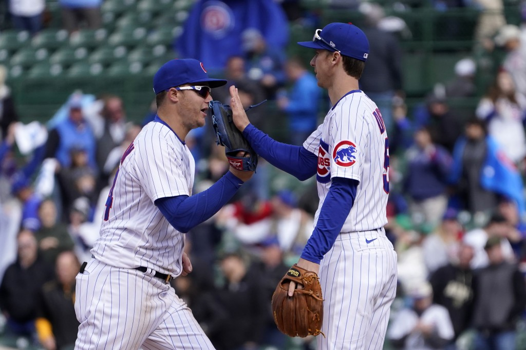 Chicago Cubs' Joc Pederson, left, and Matt Duffy celebrate their win over the Pittsburgh Pirates after a baseball game Friday, May 7, 2021, in Chicago...