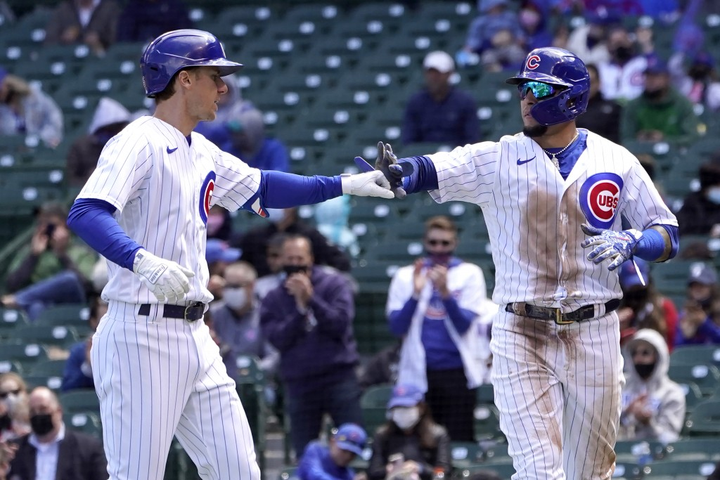 Chicago Cubs' Javier Baez, right, greets Matt Duffy outside the dugout after Baez scored on Duffy's sacrifice fly during the third inning of a basebal...