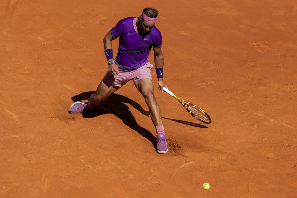 Spain's Rafael Nadal misses a ball during a tennis match against Germany's Alexander Zverev at the Mutua Madrid Open tennis tournament in Madrid, Spai...
