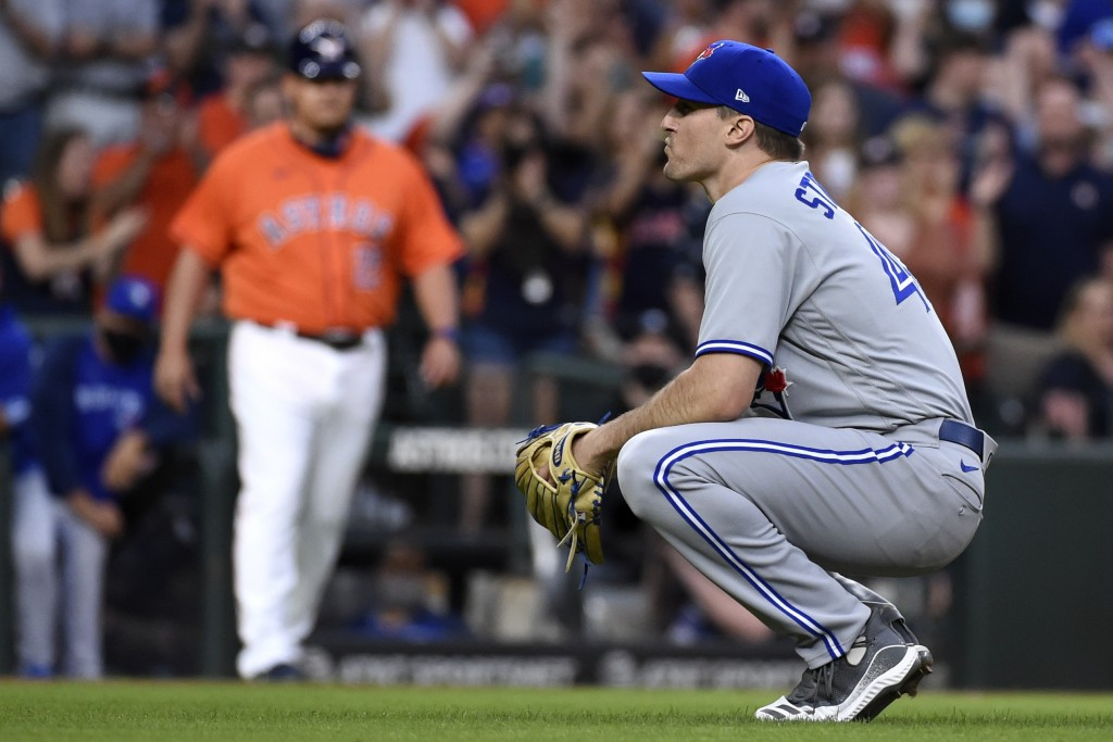 Toronto Blue Jays starting pitcher Ross Stripling reacts after walking Houston Astros' Alex Bregman with the bases loaded during the second inning of ...