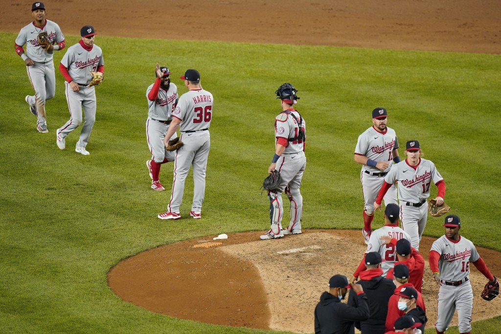 The Washington Nationals celebrate after a baseball game against the New York Yankees, Friday, May 7, 2021, in New York. (AP Photo/Frank Franklin II)
