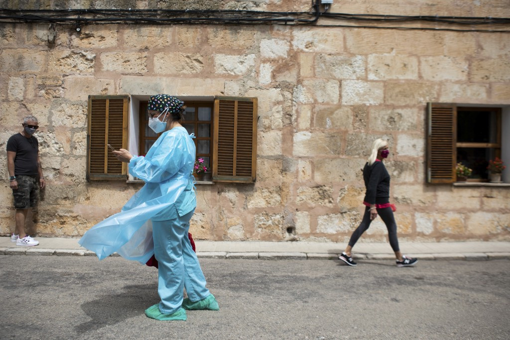 Nurse Pilar Rodríguez arrives to start visiting her patients in the town of Sa Pobla on the Spanish Balearic Island of Mallorca, Spain, Friday, April ...