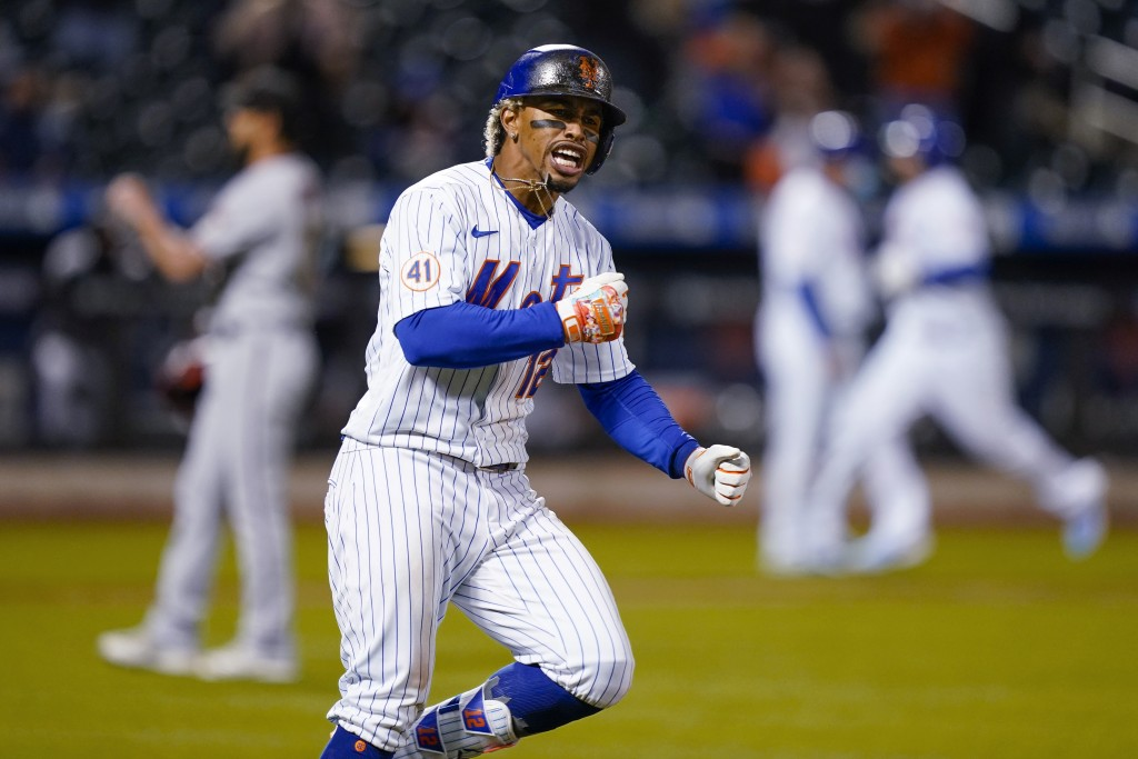 New York Mets' Francisco Lindor runs the bases after hitting a two-run home run off Arizona Diamondbacks relief pitcher Caleb Smith during the seventh...
