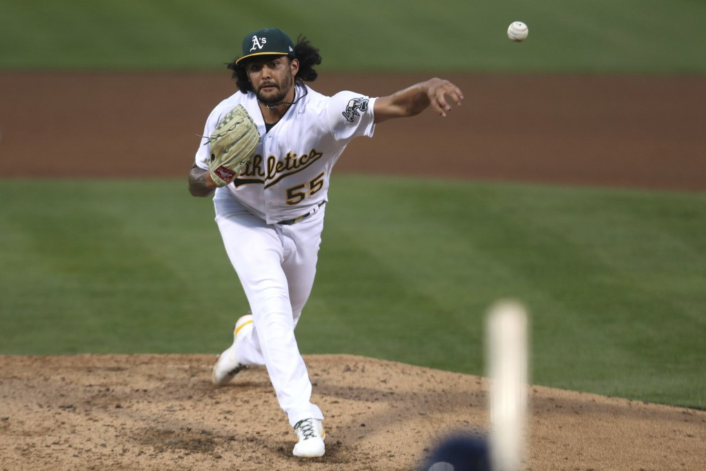 Oakland Athletics' Sean Manaea throws to a Tampa Bay Rays batter during the fifth inning of a baseball game in Oakland, Calif., Friday, May 7, 2021. (...