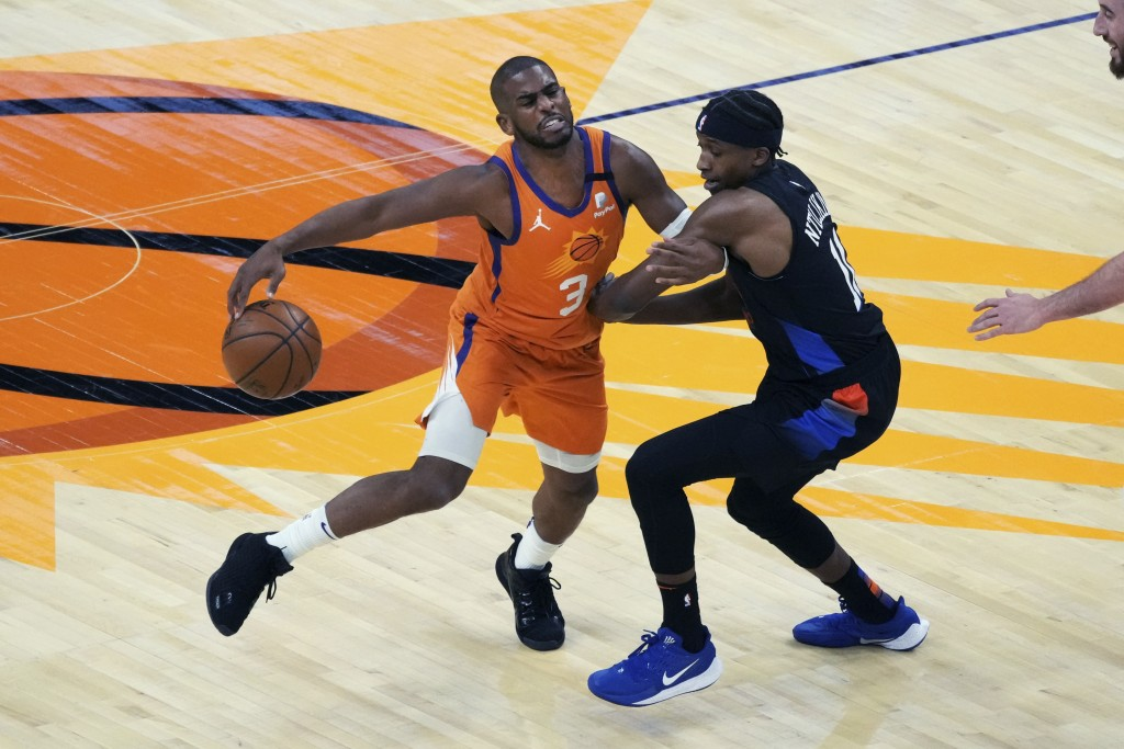 Phoenix Suns guard Chris Paul (3) is pressured by New York Knicks guard Frank Ntilikina during the first half of an NBA basketball game Friday, May 7,...
