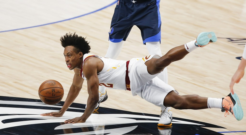 Cleveland Cavaliers guard Collin Sexton (2) is fouled by Dallas Mavericks forward Dorian Finney-Smith during the first half of an NBA basketball game,...