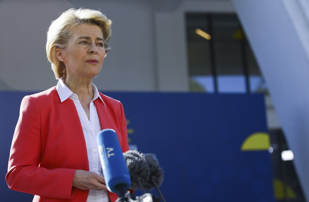 European Commission President Ursula von der Leyen speaks with the media as he arrives for an EU summit at the Crystal Palace in Porto, Portugal, Satu...