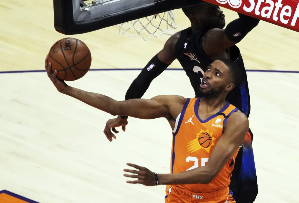 Phoenix Suns forward Mikal Bridges drives past New York Knicks center Nerlens Noel (3) during the first half of an NBA basketball game Friday, May 7, ...