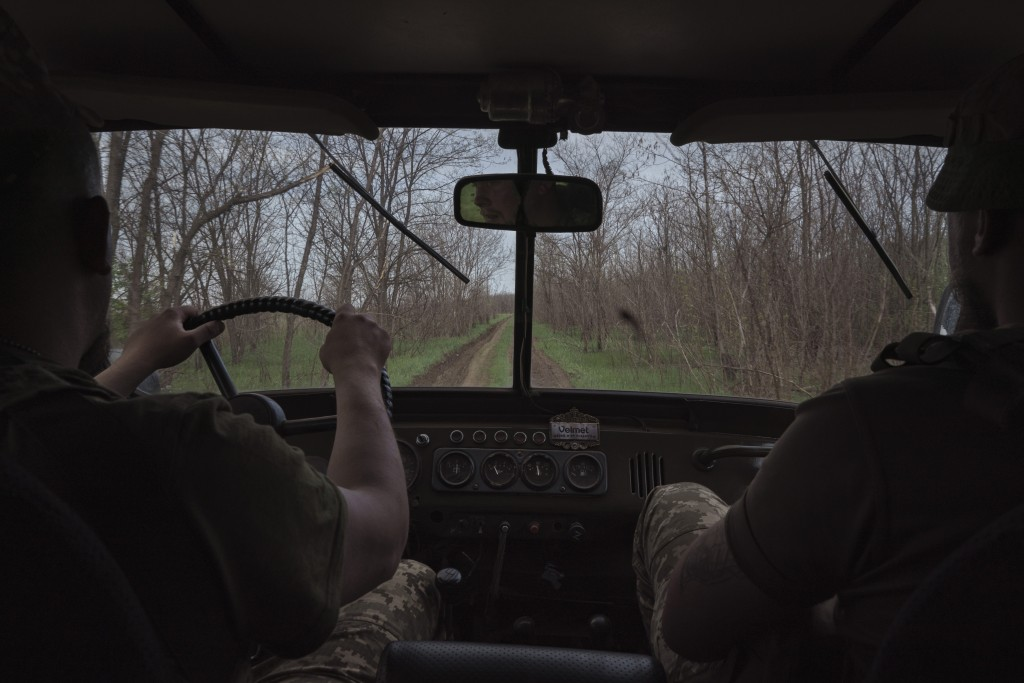 Ukrainian soldiers drive towards a fighting position on the line of separation from pro-Russian rebels near Toretsk, eastern Ukraine, Thursday, May 6,...