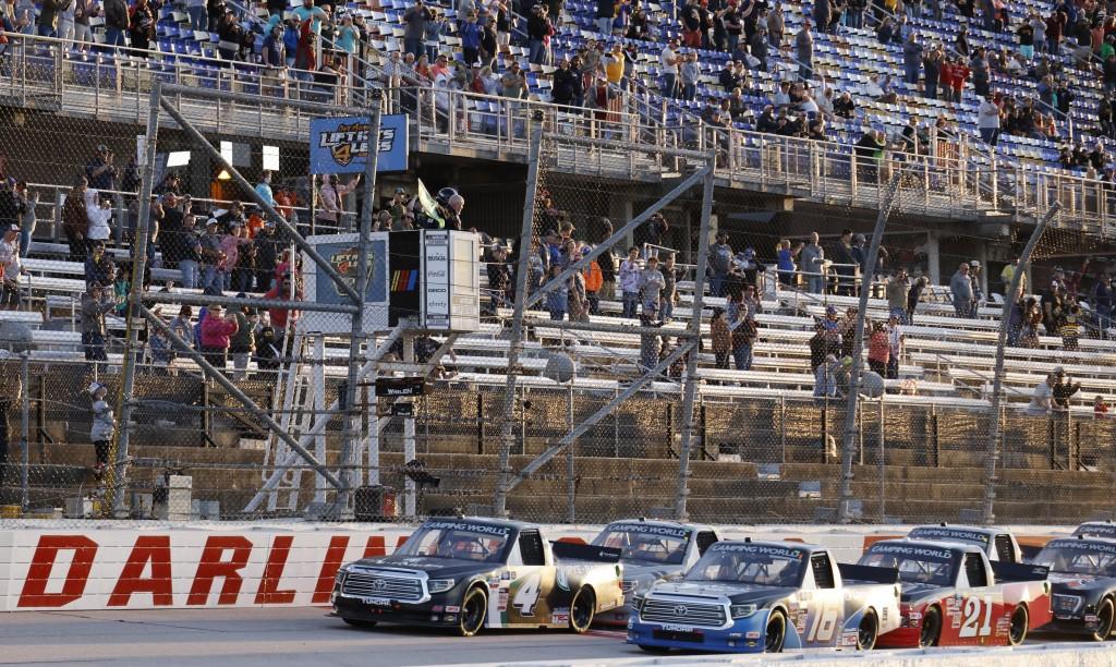 John Hunter Nemechek (4) leads the field to start the NASCAR Truck Series auto race at Darlington Raceway, Friday, May 7, 2021, in Darlington, S.C. (A...