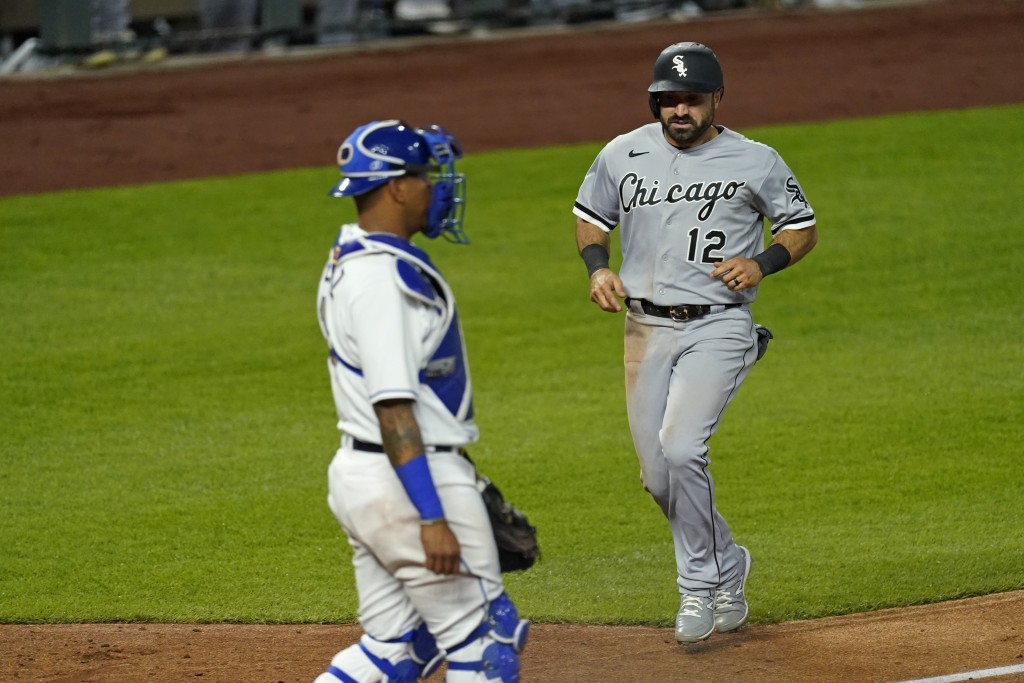 Chicago White Sox's Adam Eaton (12) runs home to score on a double by Jose Abreu during the sixth inning of the team's baseball game against the Kansa...