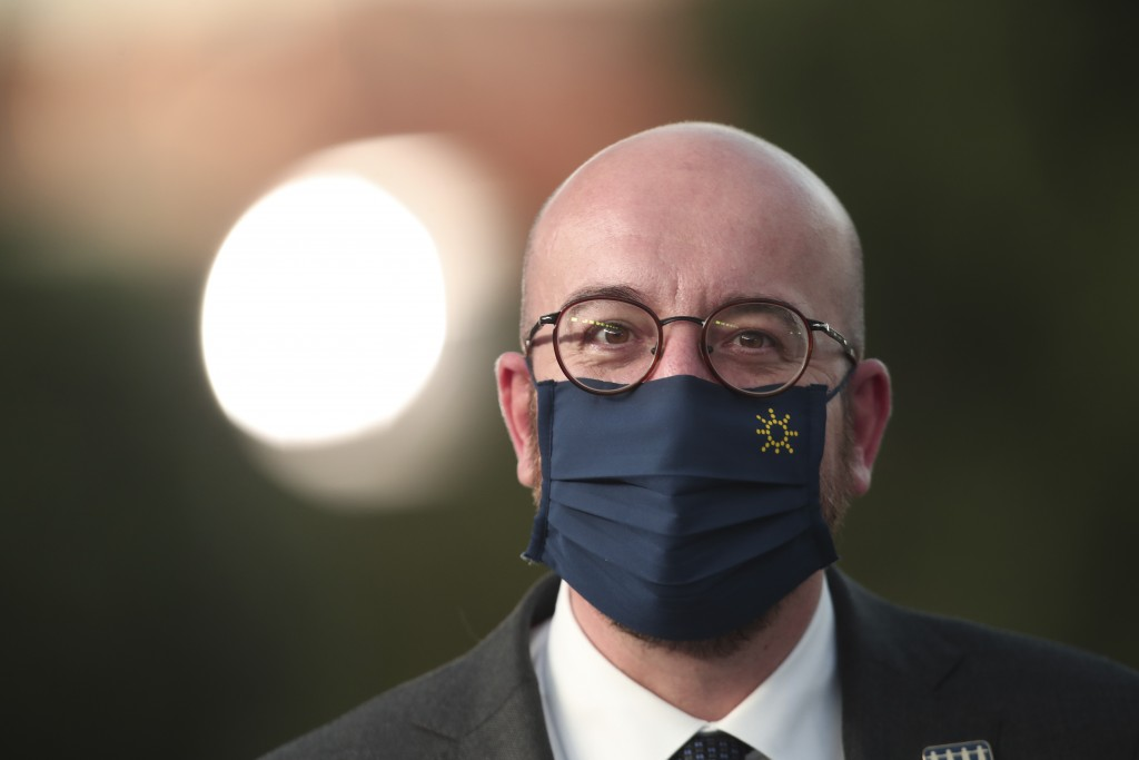 European Council President Charles Michel arrives for an informal dinner event during an EU summit at the Crystal Palace in Porto, Portugal, Friday, M...