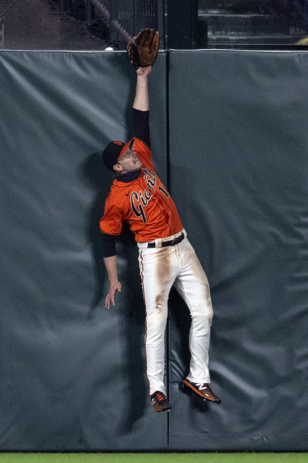 San Francisco Giants center fielder Austin Slater leaps in vain for a two-run home run by San Diego Padres' Trent Grisham's during the sixth inning of...
