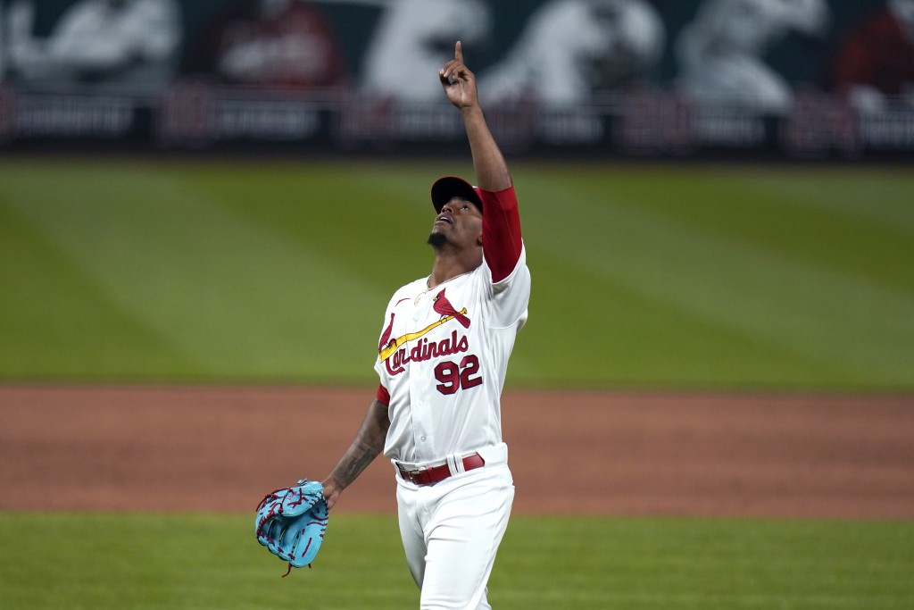 St. Louis Cardinals relief pitcher Genesis Cabrera celebrates after striking out Colorado Rockies' Charlie Blackmon to end a baseball game Friday, May...