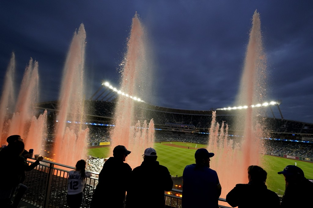 Fans watch from beyond the outfield fountains during the fifth inning of a baseball game between the Kansas City Royals and the Chicago White Sox on F...