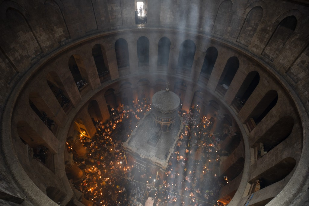 Christian pilgrims hold candles as they gather during the ceremony of the Holy Fire at Church of the Holy Sepulchre, where many Christians believe Jes...