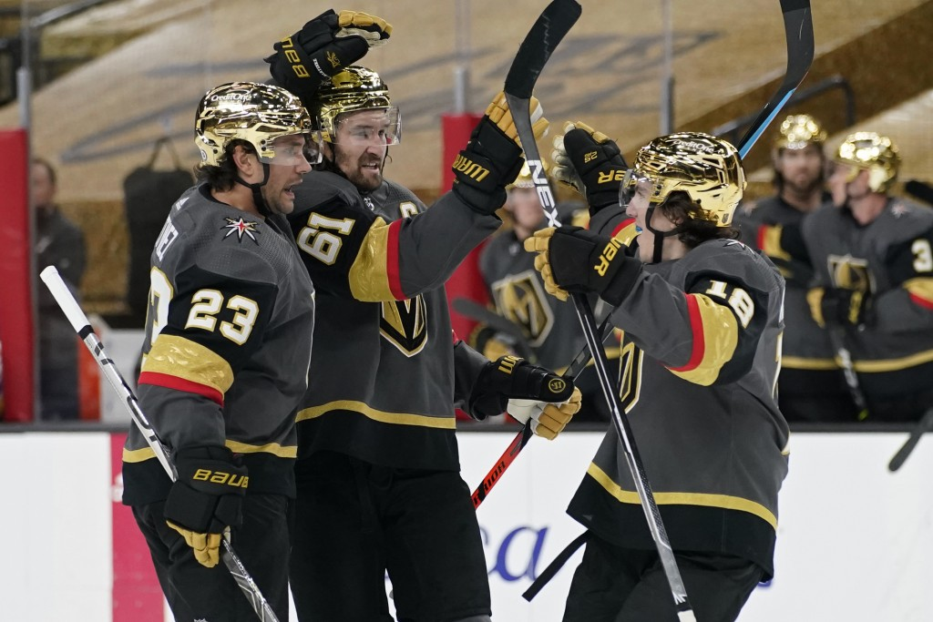 Vegas Golden Knights players celebrate after defenseman Alec Martinez (23) scored against the St. Louis Blues during the second period of an NHL hocke...