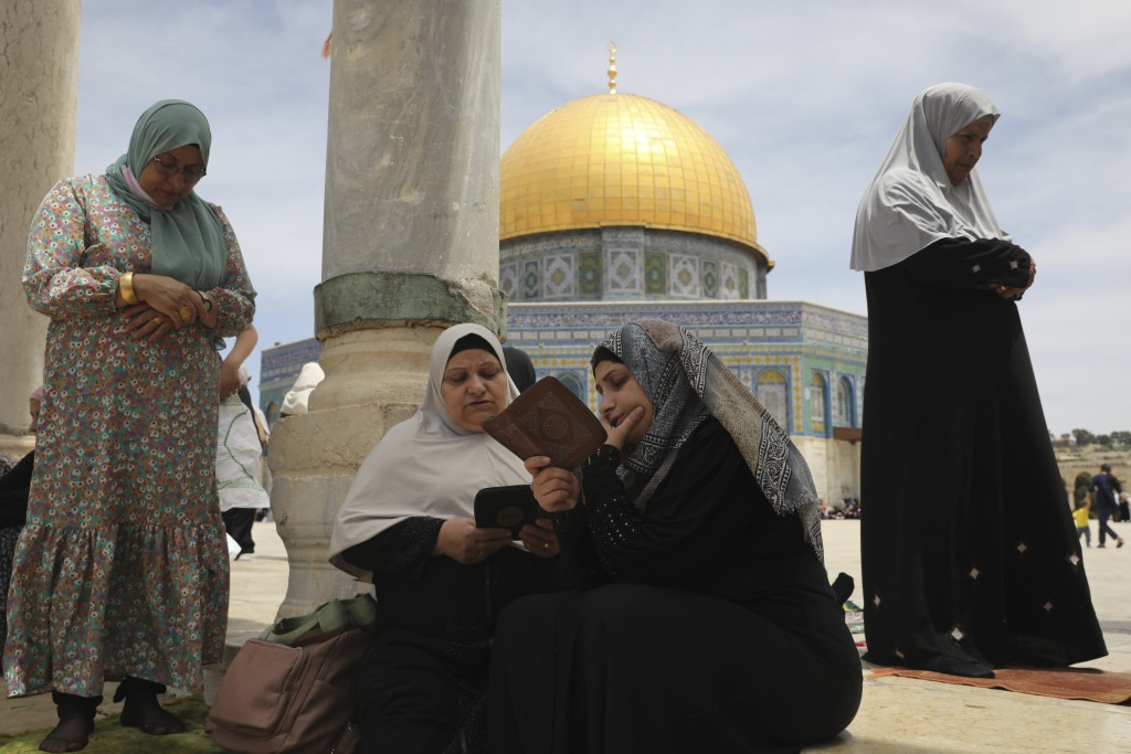 Palestinian women take part in the last Friday prayers of the Muslim holy month of Ramadan at the Dome of the Rock Mosque in the Al Aqsa Mosque compou...