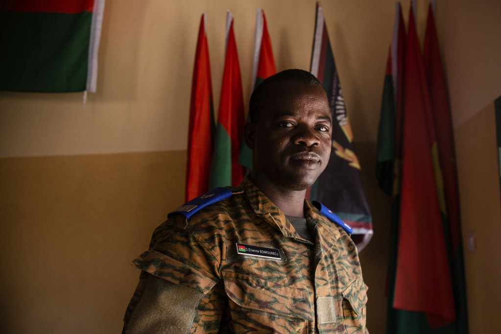 Etienne Bonkoungou, a pastor and military chaplain, stands for a portrait at the 10th RCAS army barracks in Kaya, Burkina Faso, Saturday, April 10, 20...