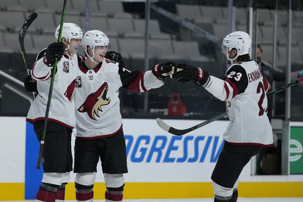 Arizona Coyotes defenseman Victor Soderstrom, center, celebrates with Jan Jenik, left, and Oliver Ekman-Larsson (23) after scoring a goal against the ...