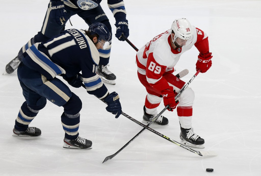 Detroit Red Wings forward Sam Gagner, right, chases the puck in front of Columbus Blue Jackets forward Kevin Stenlund during the second period of an N...