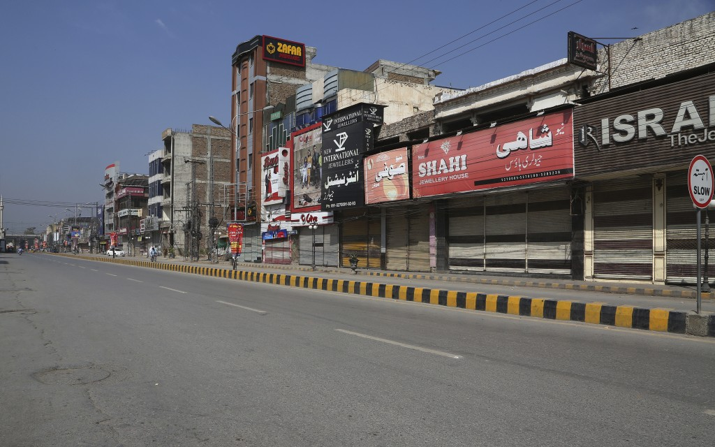 A market is deserted due to the closure after the government announced new restrictions for the COVID-19 measures, in Peshawar, Pakistan, Saturday, Ma...