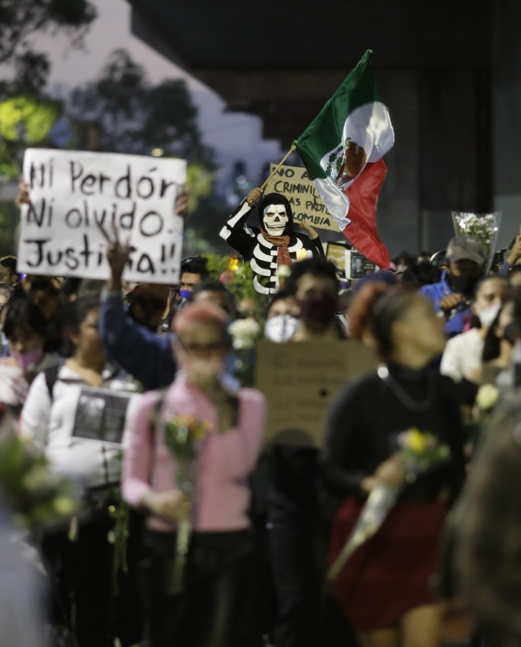 People march demanding justice for the people who died in Monday's subway collapse, in Mexico City's south side, Friday, May 7, 2021. An elevated sect...
