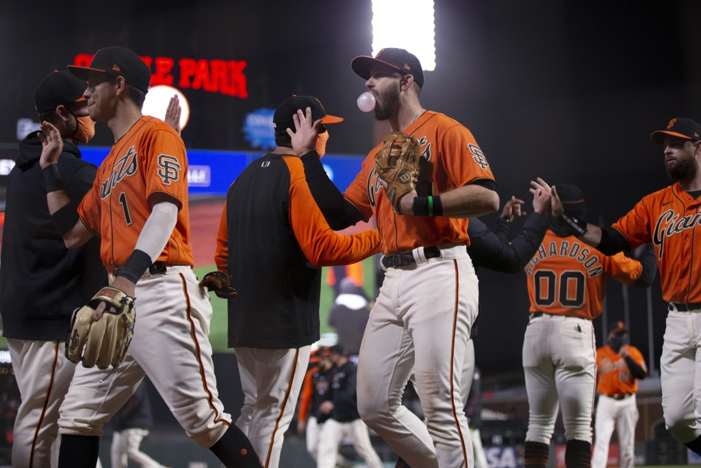 San Francisco Giants celebrate a 5-4 victory over the San Diego Padres in a baseball game Friday, May 7, 2021, in San Francisco. (AP Photo/D. Ross Cam...